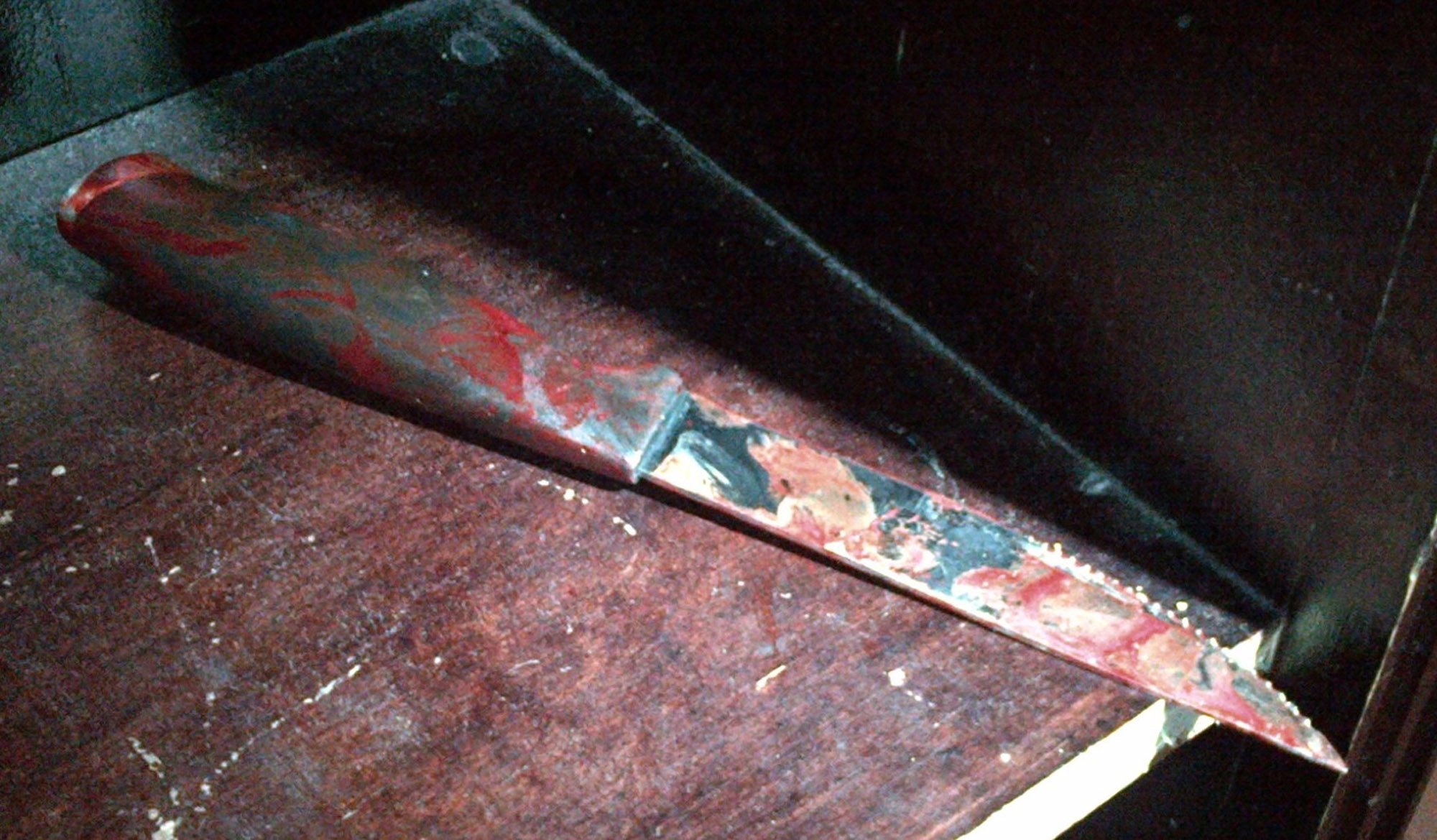 A blood-stained nine-inch (23 cm) knife is seen after being recovered at the scene of a stabbing at a Brooklyn synagogue